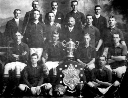 "Stella Football Club - 1910 Standing Top Row: H. Moore; W.N. Sperryn; Alfred Clark; D. East Standing: A. Williams; Robert Douglas (married Amelia ""Minnie"" Clark); W. Weber; F.D. Chase; L. Smith; H.F. Smith (married Emily Maud Clark) Seated: T. Ballantyne; Frank Clark (Capt.); Herbert Clark (V. Capt.); E. Parton Sitting Front: J. Lewis; Edgar Clark"