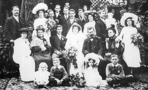 "Eales - Clark Wedding Group (December 9, 1903) Standing: Ernie Eales; ?; Christopher Clark; Peter Clark; George Clark; William Burden; ?; Francis (""Frank"") Clark; Edith Burden (nee Clark); Marion Clark (nee McConnell); Tom Clark with Edith Clark; Emily Clark. Seated: Ada Eales; Mary Eales; Alfred Eales; Mary Jane (""May"") Eales (nee Clark); George Clark; Hannah Clark Foreground: Arthur Clark; Leonard Clark; Muriel Clark; Sydney Eales"